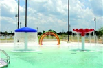Variety of water sprays in a pool area.